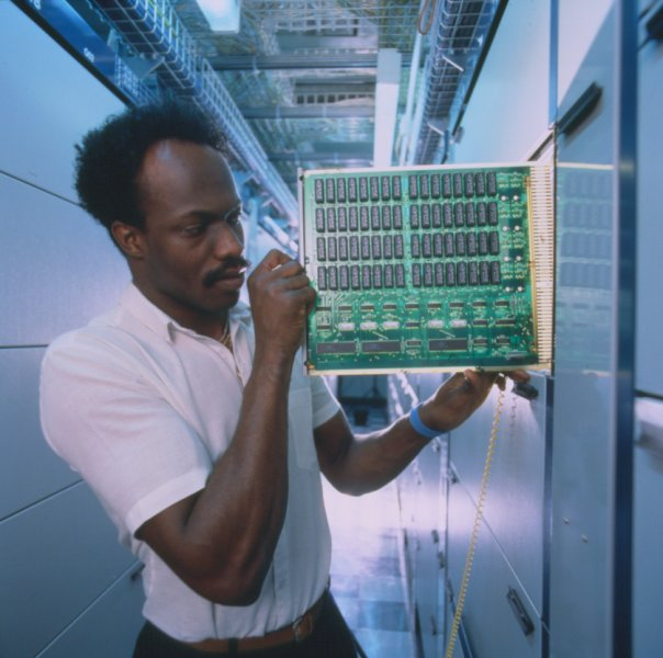 BT engineer working on digital telephone exchange, 1990. Image courtesy of BT Heritage.